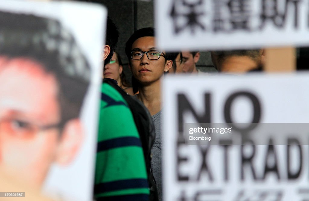 Protesters hold placards outside government headquarters during a rally in support of <a gi-track='captionPersonalityLinkClicked' href=/galleries/search?phrase=Edward+Snowden&family=editorial&specificpeople=10983676 ng-click='$event.stopPropagation()'>Edward Snowden</a>, the former National Security Agency contractor, in Hong Kong, China, on Saturday, June 15, 2013. Protesters marched to Hong Kongs government headquarters demanding their leaders protect <a gi-track='captionPersonalityLinkClicked' href=/galleries/search?phrase=Edward+Snowden&family=editorial&specificpeople=10983676 ng-click='$event.stopPropagation()'>Edward Snowden</a>, who fled to the city after exposing a U.S. surveillance program. Photographer: Luke Casey/Bloomberg via Getty Images
