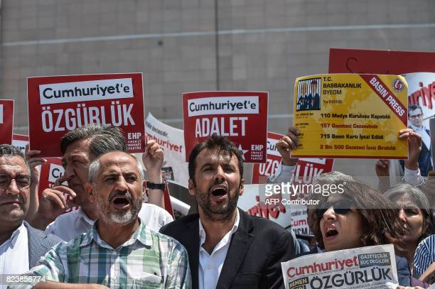 Protesters hold placards reading 'Justice for Cumhuriyet' on July 28 2017 during a demonstration in front of Istanbul's courthouse A Turkish court...