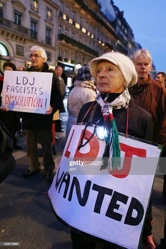 Protesters hold placards reading 'LDJ Wanted' and 'LDJ - fascists - dissolution' during a demonstration with about 120 members of the 'Indigenous of the Republic's Party' (PIR), on November 8, 2012 in front of France's Justice Ministry in Paris, to claim the dissolution of the Jewish Defence League (LDJ), as they accuse this jewish organisation of far-right attacks on pro-Palestinian supporters. On October 25, the LDJ uploaded on Youtube website a video showing PIR's spokeswoman Houria Bouteldja and pro-Palestinian militants Olivia Zemor and Jacob Cohen, sprayed with red paint after being assaulted by LDJ members.