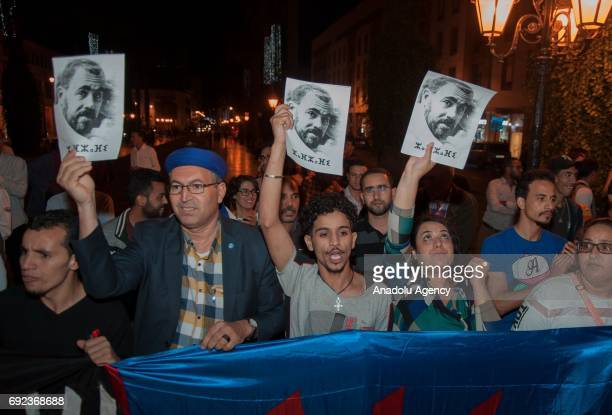 Protesters hold portraits of grassroots leader Nasser Zefzafi during a demonstration in solidarity with Morocco's neglected Rif region in front of...