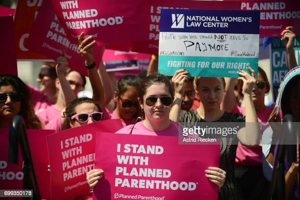 Protesters hold posters in support of Planned Parenthood at a rally to oppose the repeal of the Affordable Care Act and its replacement on Capitol...