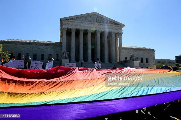 Protesters hold progay rights flags outside the US Supreme Court on April 28 2015 in Washington DC The Supreme Court meets to hear arguments whether...