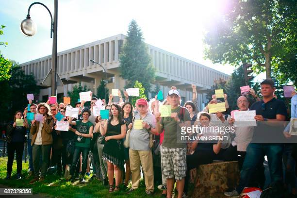 Protesters hold sign during a demonstration in support of gay rights and against homophobia in Chechnya in front of the Russian Embassy in Paris on...