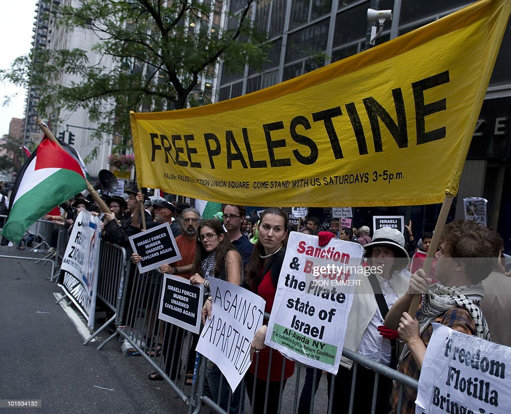 Protesters hold signs during a rally June 1, 2010 in New York against an Israeli raid on a Gaza-bound aid flotilla. US Secretary of State Hillary Clinton said the United States backs the Israeli investigation of the ship raid but it must be 'prompt, impartial, credible and transparent.'