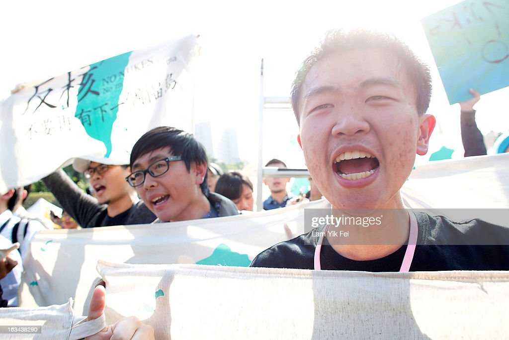 Protesters hold signs during an anti-nuclear rally on March 10, 2013 in Taipei, Taiwan. Tens of thousands of protesters took to the streets in Taiwan calling on the government to shut down the island's nuclear power plants, citing the painful lesson of Japan's nuclear crisis after a 9.0-magnitude earthquake two years ago.