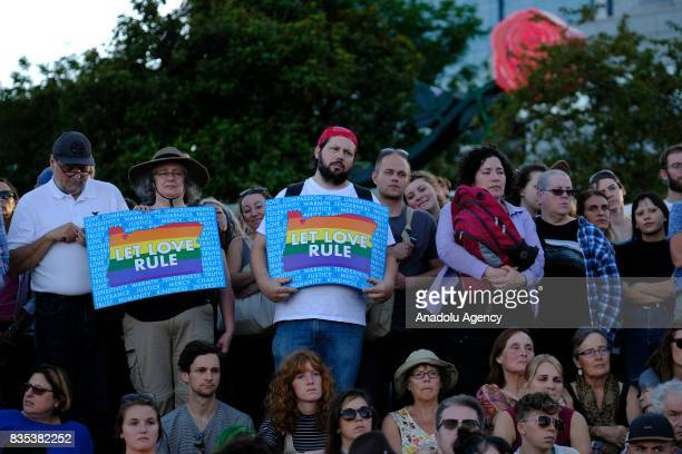Protesters hold signs in support of love during a rally on the waterfront in Portland Ore United States on August 18 to show solidarity against hate...