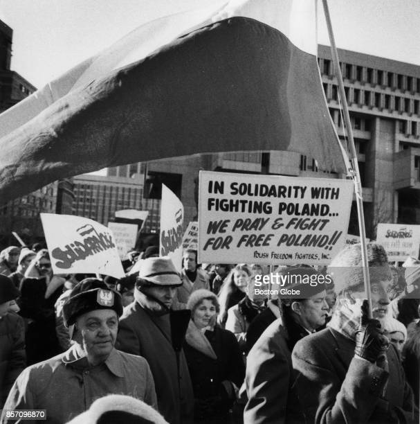 Protesters hold signs near Faneuil Hall in support of the Polishsolidarity union in Boston Dec 20 1981