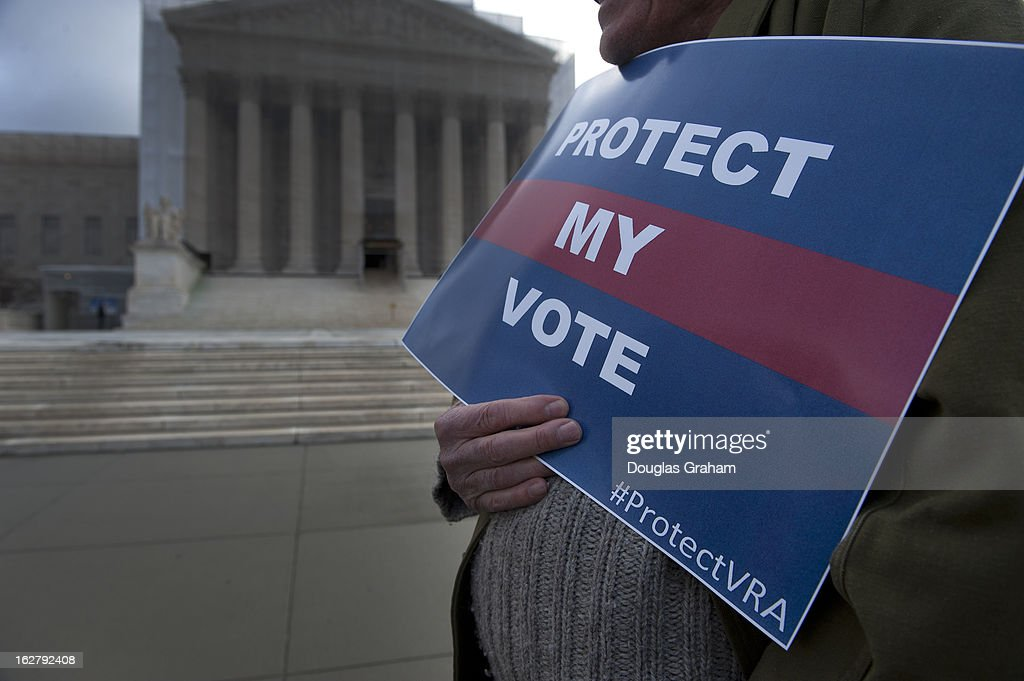 Protesters hold signs outside the Supreme Court as the Shelby County, Alabama v. Holder oral arguments where set to begin at the Supreme Court on the importance of protecting the right to vote for all Americans on February 27, 2013.