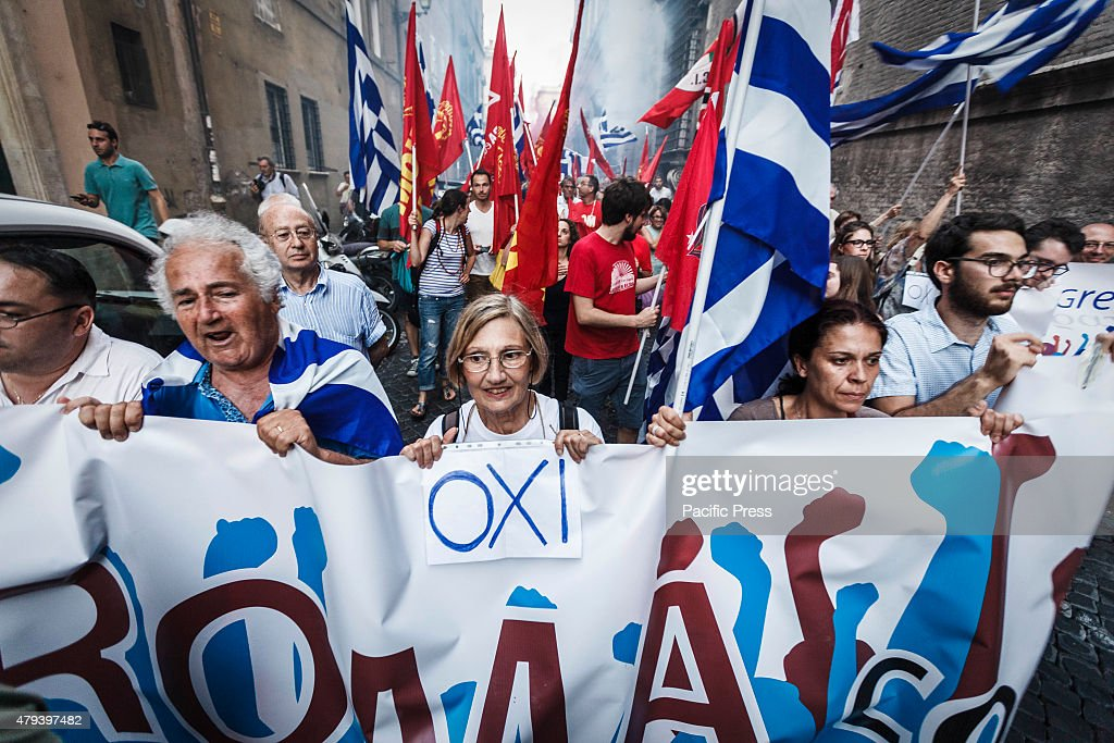 Protesters hold signs reading 'Oki' as they takes part in a rally to support No vote at the upcoming Greek referendum on European Union austerity in...
