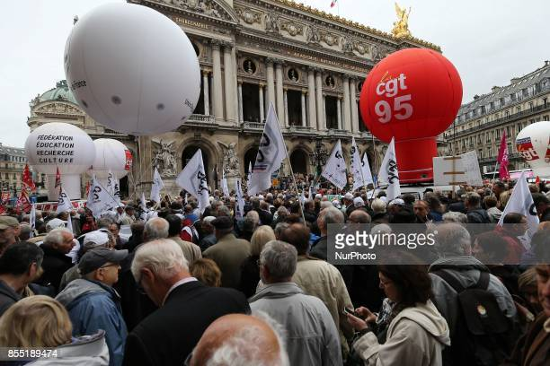 Protesters hold union flags as pensioners demonstrate in front of the Palais Garnier opera house in Paris on September 28 2017 against the increase...
