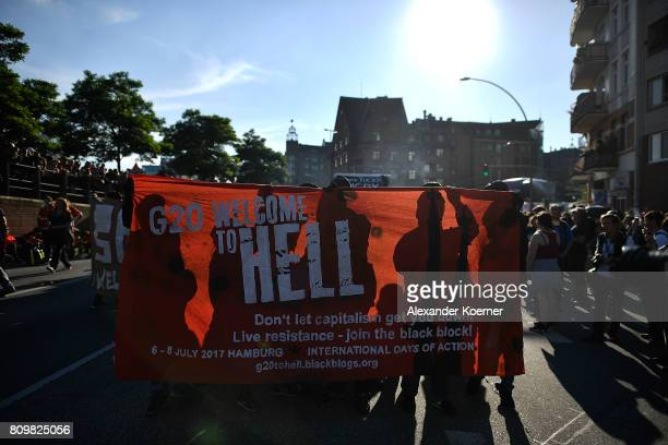 Protesters hold up a banner as they take part in the 'Welcome to Hell' protest march on July 6 2017 in Hamburg Germany Leaders of the G20 group of...