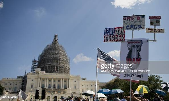 Protesters hold up a placard during a Tea Party rally against the international nuclear agreement with Iran outside the US Capitol in Washington DC...