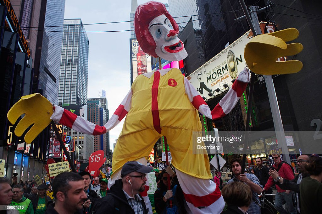 Protesters hold up a Ronald McDonald puppet at a rally in support of minimum wage increase in New York US on Wednesday April 15 2015 Fastfood workers...