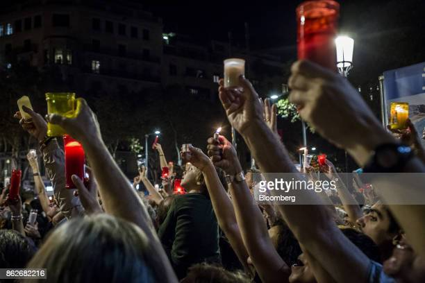 Protesters hold up candles during a vigil to demand the release of imprisoned seperatist leaders Jordi Sanchez head of the Catalan National Assembly...