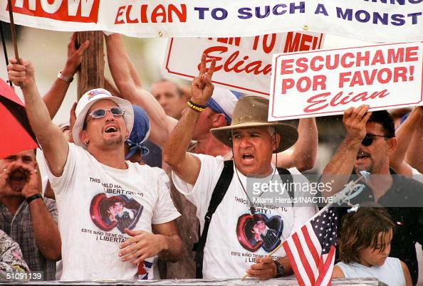 Protesters Hold Up ProElian Signs As They And Other Supporters Stage A Continuous Rally Outside The Home Of Lazaro Gonzalez In The Little Havana...