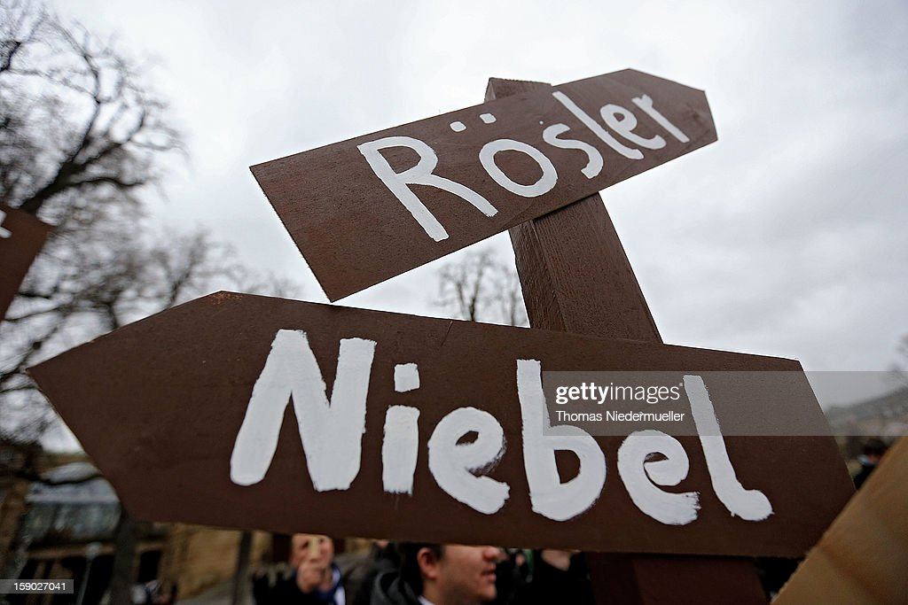 Protesters hold up sign posts prior to the annual Epiphany conference at the state opera house on January 6, 2013 in Stuttgart, Germany.