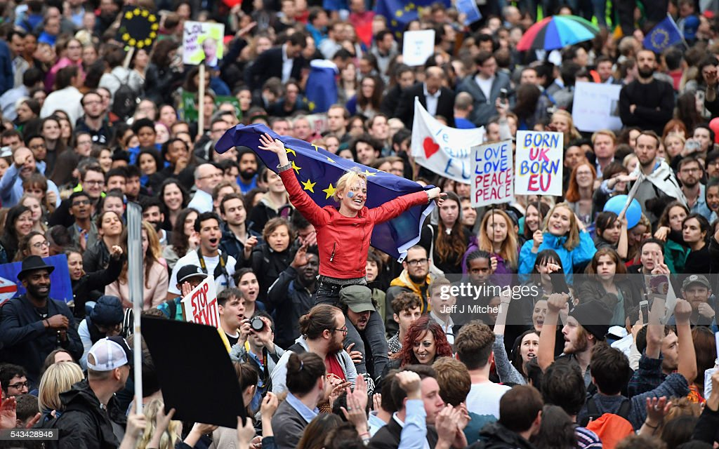 Protesters hold up signs and flags as they demonstrate against the EU referendum result outside the Houses of Parliament on June 28, 2016 in London, England. Up to 50,000 people were expected before the event was cancelled due to safety concerns. In the early evening a crowd still convereged on the square to vent their anti-Brexit feelings, before the protest moved to the Houses of Parliament.