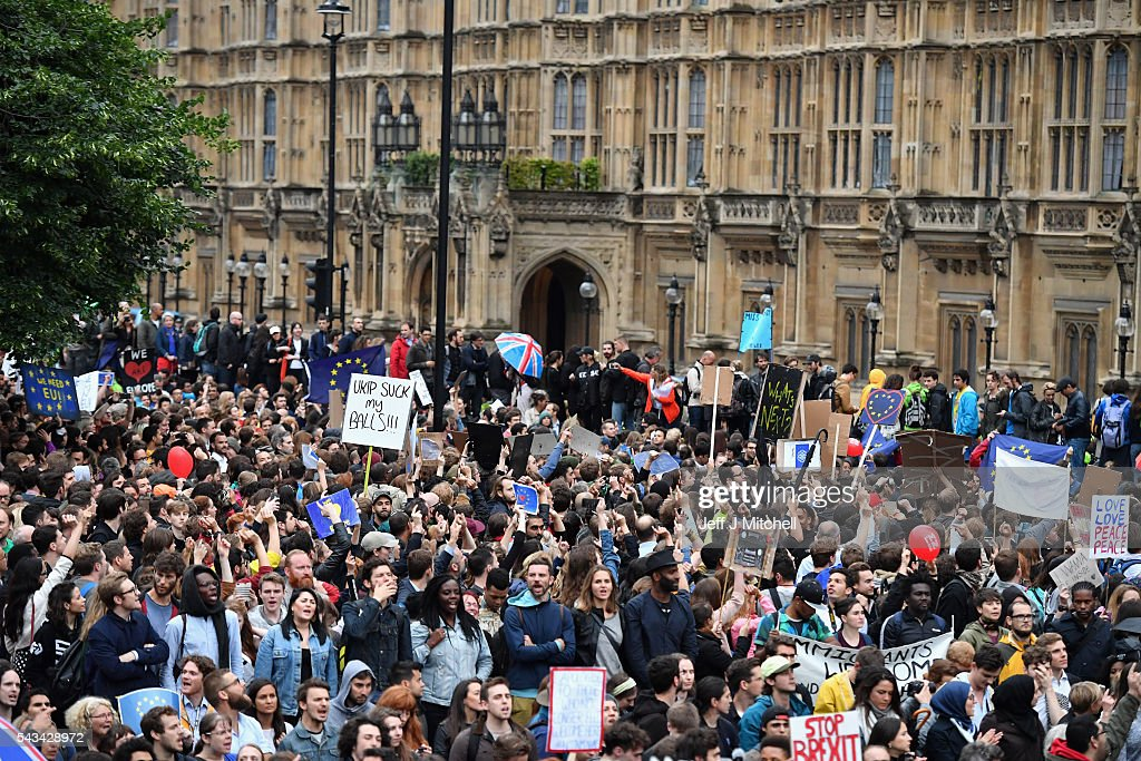 Protesters hold up signs as they demonstrate against the EU referendum result outside the Houses of Parliament on June 28, 2016 in London, England. Up to 50,000 people were expected before the event was cancelled due to safety concerns. In the early evening a crowd still convereged on the square to vent their anti-Brexit feelings, before the protest moved to the Houses of Parliament.