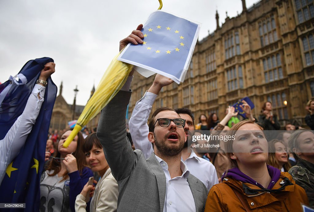 Protesters hold up signs as they demonstrate against the EU referendum result outside the Houses of Parliament on June 28, 2016 in London, England. Up to 50,000 people were expected before the event was cancelled due to safety concerns. In the early evening a crowd still converged on the square to vent their anti-Brexit feelings, before the protest moved to the Houses of Parliament.