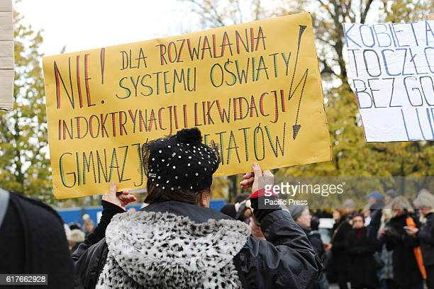 Protesters hold up signs that read 'No For destroying the system for indoctrination' during a 'black protest' in Warsaw Poland on October 23 2016 in...