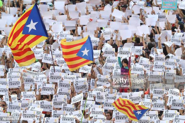 Protesters hold up signs to demand the release of imprisoned Catalan leaders Jordi Sanchez and Jordi Cuixart at a demonstration for Catalan...