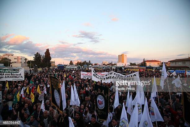 Protesters holding banners and plakat against ECB members and Mario Draghi Around 4000 protesters participated in the mass antiausterity rally on...