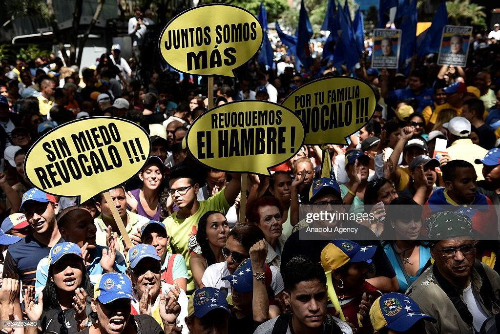 Protesters holding banners during an anti-government demonstration outside the Supreme Tribunal of Justice (TSJ) in Caracas, Venezuela on May 25, 2016. Protesters seeking to drive Venezuela's President Nicolas Maduro from office launched fresh street rallies.