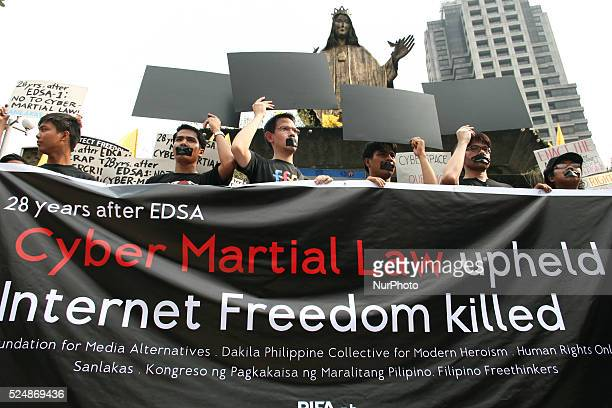 Protesters holding black card boards as an outcry of the alleged curtailment of the freedom of speech by the Cybercrime Law during the Black Tuesday...