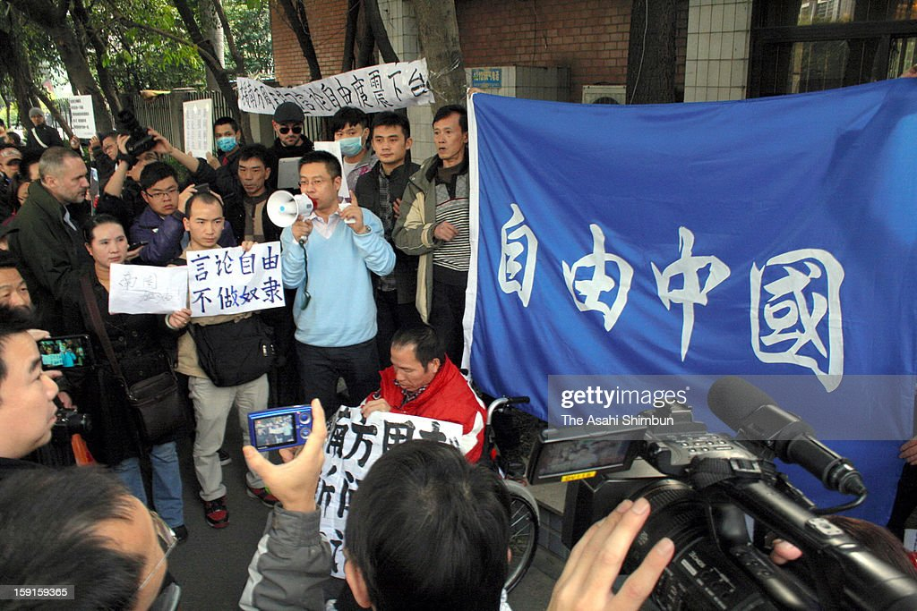 Protesters holding 'Democratic China' demonstrate against the Chinese government sensorship by altering the paper's New Year editorial greeting in front of the Nanfang Media Group office on January 8, 2013 in Guangzhou, China.