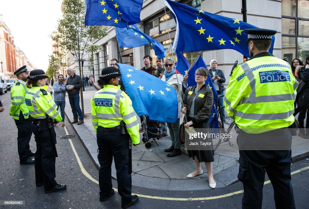 Protesters holding flags of Europe demonstrate outside BBC's Broadcasting House as British Prime Minister Theresa May and her husband Philip May give a joint interview on the One Show on May 9, 2017 in London, England. Campaigning is underway ahead of the June 8th general election.
