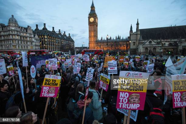 Protesters holding placards take part in a rally in Parliament Square against US president Donald Trump's state visit to the UK on February 20 2017...