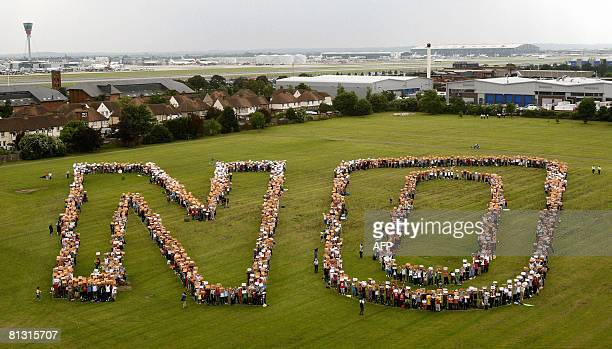 Protesters holding posters marked 'NO' form the word 'NO' as the take part in a march against plans to expand London's Heathrow airport with a third...