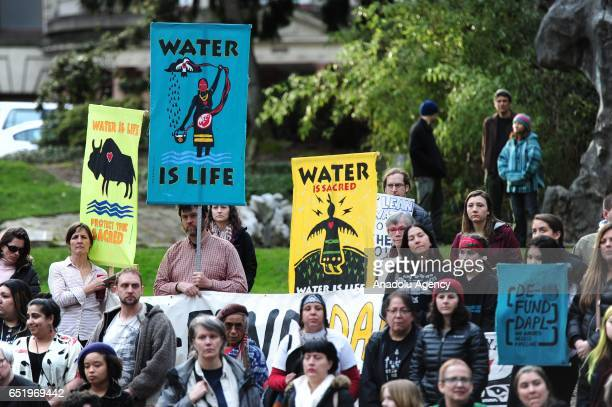 Protesters holding signs show solidarity with the 'Native Nations Rise' march on Washington DC against the construction of the Dakota Access Pipeline...