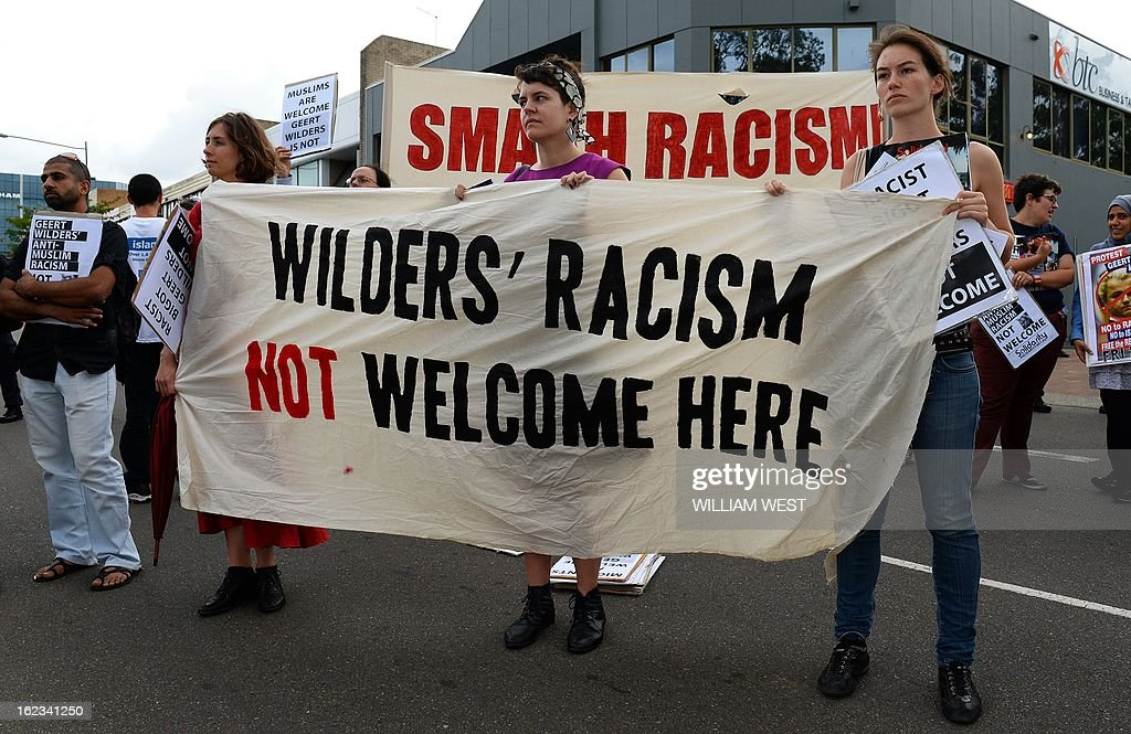 Protesters holds a placard outside a venue where right-wing Dutch MP Geert Wilders delivers a speech to the conservative Q Society of Australia, in Sydney on February 22, 2013. Wilders is on the third leg of his controversial tour of Australia and about 100 people, many carrying anti-Wilders placards, protested outside the front of the function centre in the outer Sydney suburb of Liverpool. AFP PHOTO/William WEST