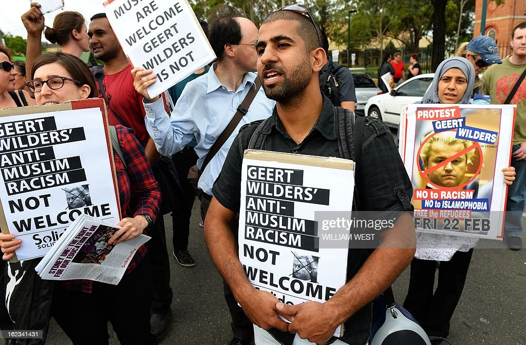 Protesters holds a placards outside a venue where right-wing Dutch MP Geert Wilders delivers a speech to the conservative Q Society of Australia, in Sydney on February 22, 2013. Wilders is on the third leg of his controversial tour of Australia and about 100 people, many carrying anti-Wilders placards, protested outside the front of the function centre in the outer Sydney suburb of Liverpool. AFP PHOTO/William WEST