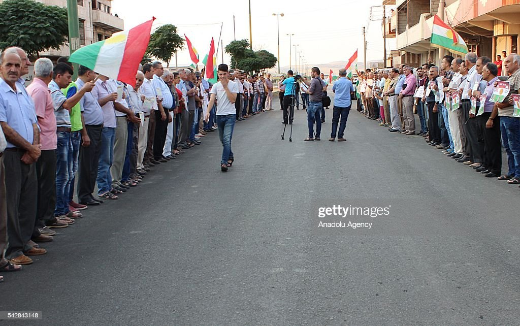 Protesters holds banners, demanding the liberation of prisoners in PYD's jail and PYD members to stop kidnapping of political opposition members, during a protest held for political detentions against Kurdish people in Al-Hasakah, Syria on June 24, 2016. PYD and its armed wing YPG is a terrorist organization as well as the Syrian branch of terrorist organization PKK. PKK is recognized as a terrorist organization by United States, European Union (EU) and several other countries around the world. PKK has been staged varied terrorist attacks on civilians over 30 years in Turkey and some other countries.