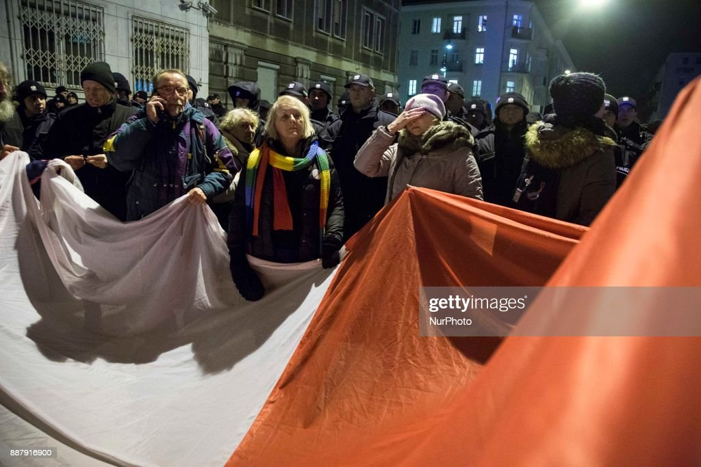 Protesters holds polish flag during illegal demonstration near Polish parliament organized by opposition group Obywatele RP in Warsaw on December 7, 2017.