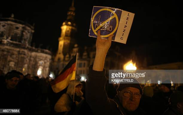 A protesters holds up a drawing of a crossed out mosque during a rally of the 'Patriotic Europeans Against the Islamisation of the Occident' in...
