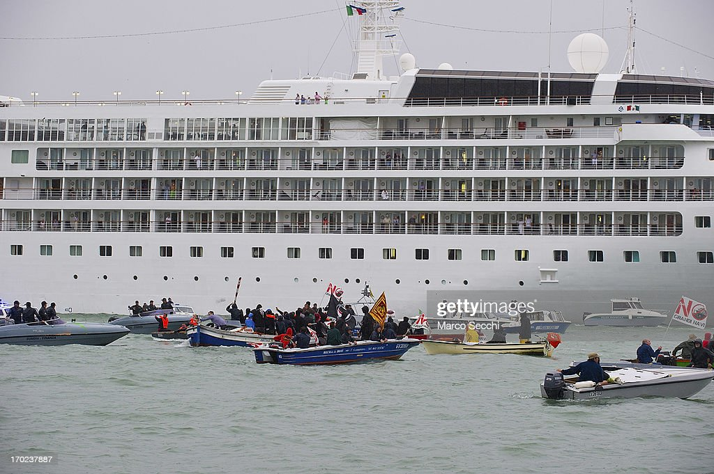 Protesters in small boats block the exit from Venice Port of large cruises delaying their departure for several hours on June 9, 2013 in Venice, Italy. Three days of protests are being organised by Venetians and environmentalists, who are opposed to cruise ships crossing the St Mark's Basin.