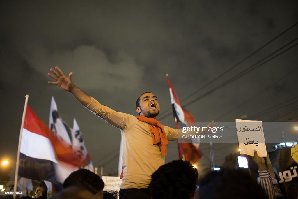Protesters in the street protesting against the Egyptian President President Morsi outside the Presidential Palace on December 4, 2012 in Cairo,Eqypt.