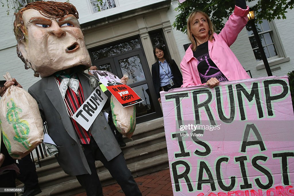 Protesters including Code Pink cofounder Medea Benjamin gather outside of the RNC headquarters where Republican presidential candidate Donald Trump...