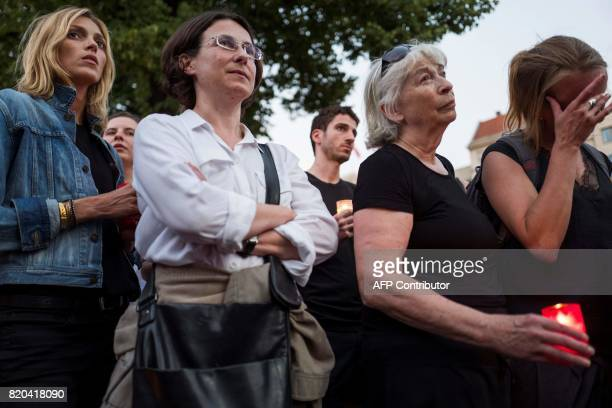 Protesters including Polish top model Anja Rubik take part in a candlelit vigil at the site of the Polish embassy in Berlin on July 21 2017 to...