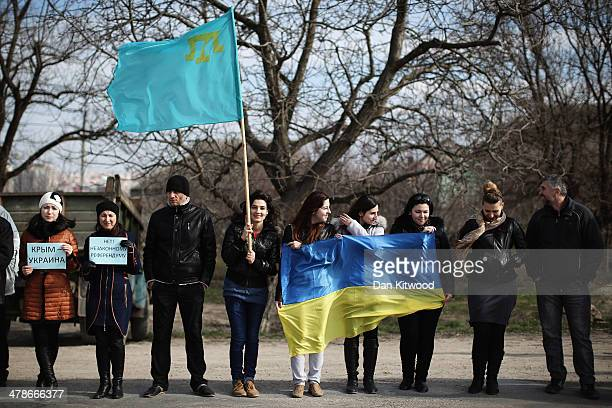 Protesters including Ukrainians and Tatars join a protest against the forthcoming referendum in Crimea on March 14 2014 in Simferopol Ukraine As the...