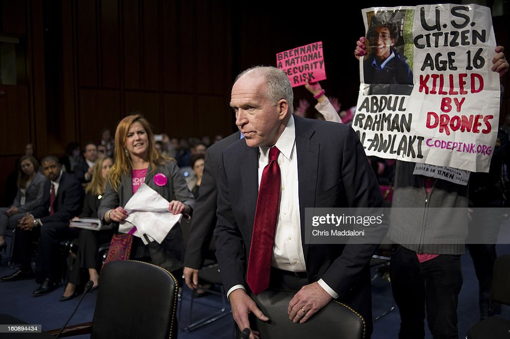 Protesters interrupt the start of a nomination hearing for U.S. Assistant to the President for Homeland Security and Counterterrorism John Brennan before the Senate Intelligence Committee. Brennan is the nominee to be the next Director of the Central Intelligence Agency, and is expected to face harsh questioning the drone targeted killing program.