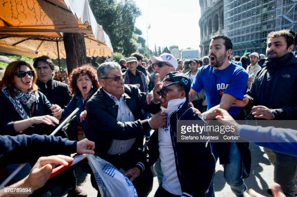 A protester's Jewish community was stopped by protesters filo_palestinesi as he tries to wrest a Palestinian flag during the march for the Liberation...
