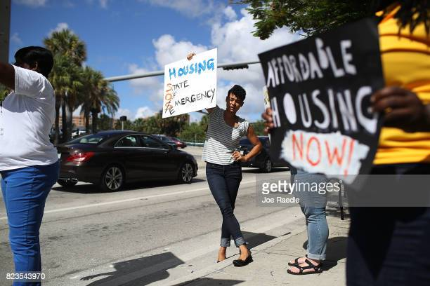 Protesters join together across the street from a condo that is being built as they ask for affordable housing to be set aside in the city and county...