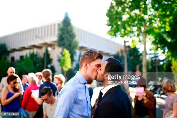 TOPSHOT Protesters kiss during a demonstration in support of gay rights and against homophobia in Chechnya in front of the Russian Embassy in Paris...
