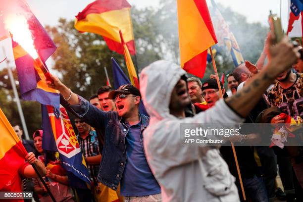 Protesters light flares during an ultraright wing antiseparatist demonstration for the unity of Spain called by 'Falange Espanola' during the Spanish...