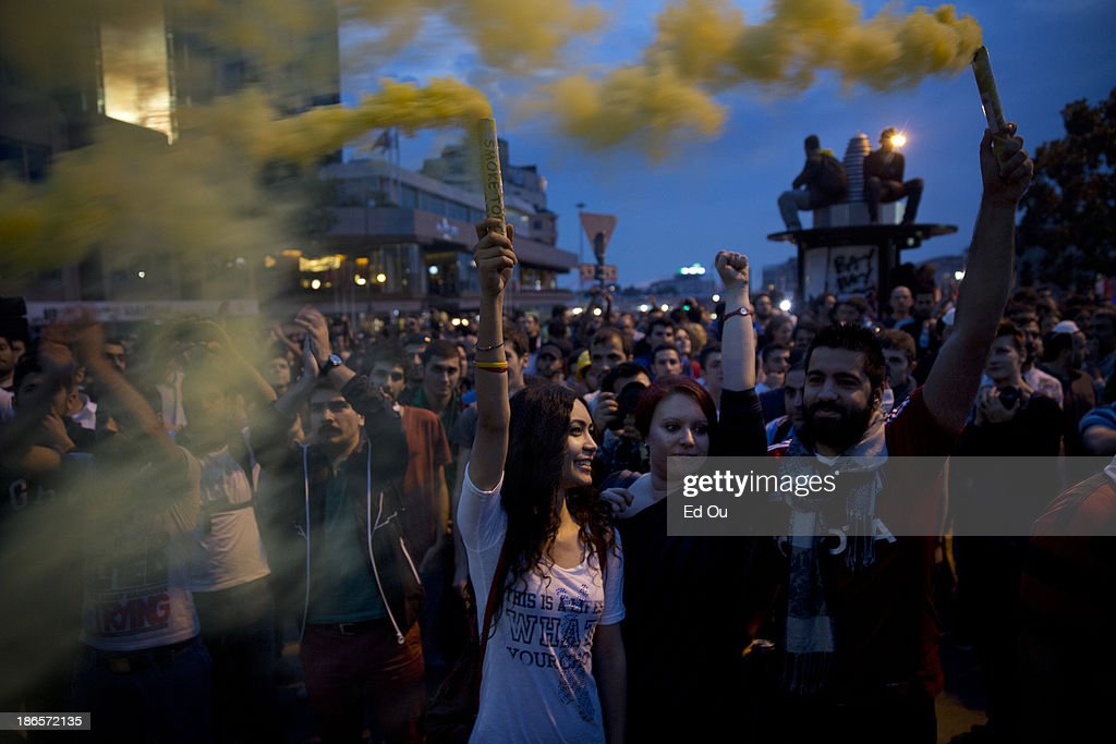 Protesters light smoke flares at a gathering in Taksim Square in Istanbul Turkey on June 4 2013 Demonstrations have sprout up across Turkey since a...