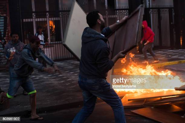 Protesters linked to the social movements Front for Housing Struggle fire tires in protest against the Social Security and Labor Reforms proposed by...